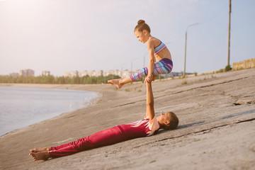 Aluminium Prints Gymnastics boy and girl professional gymnast outdoor