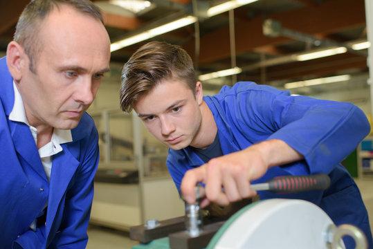 Apprentice using socket wrench