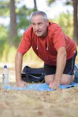mature male athlete exercising in nature