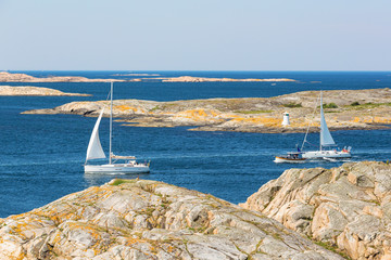 Sailing boats in rocky sea archipelago in the Swedish west coast