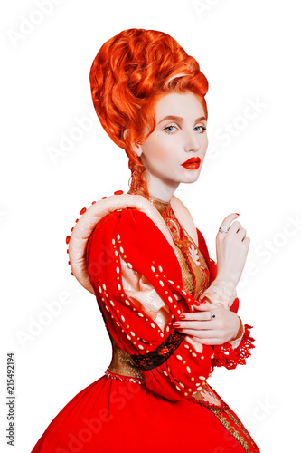 d721cbc4e148 Young renaissance redhead queen with hairstyle isolated on white background.  Renaissance princess with red hair isolated. Fairytale queen in red dress.