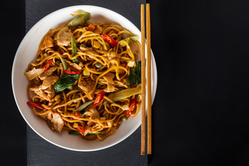 wok stir-fry egg noodles with fried chicken and thai spices and, traditional spicy asian cuisine food
