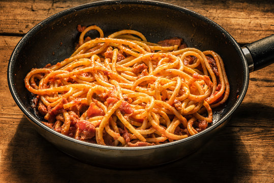 Classical Italian Pasta Amatriciana in a frying pan