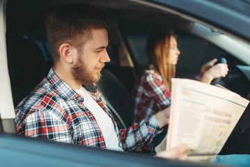 Fototapete - Instructor taking the exam, female student drives