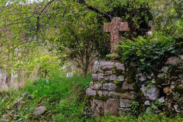 Ancient stone cross in Cue. Asturias, Spain.