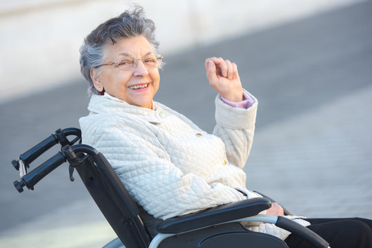 happy grandmother in a wheelchair