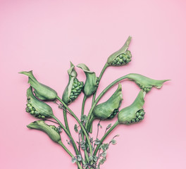 Green calla flowers bunch on pastel pink background, top view. Creative floral and botanical layout. Nature concept