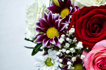 Flowers in a bouquet, festive background of a rose