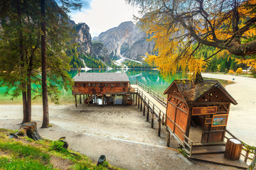 Wall Mural - Fantastic wooden boathouse with alpine lake, Dolomites, Italy, Europe