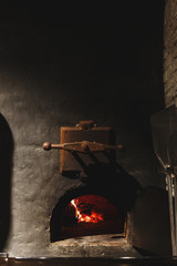 Fire burning in black iron stove, closeup