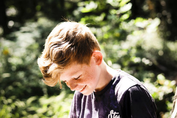 Boy laughing in the woods