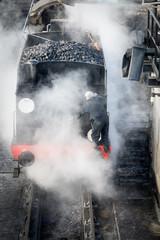 Steam train getting cleaned