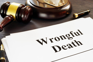 Wrongful Death report and gavel in a court. - fototapety na wymiar