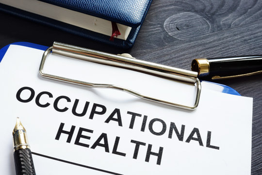 Occupational health report, pen and notepad.