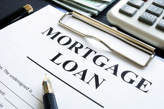 Mortgage loan form, money and calculator.