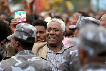 A man reacts during the funeral ceremony of Simegnew Bekele EthiopiaÕs Grand Renaissance Dam Project Manager who was found dead in his vehicle on Thursday in Addis Ababa