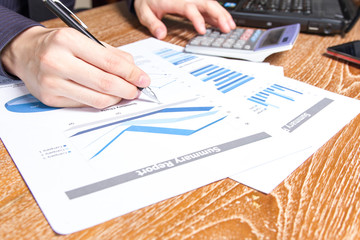 business man analyzing graph and chart document report