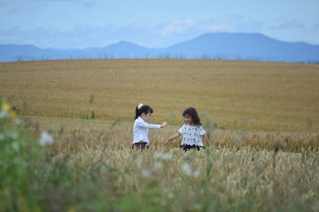 Two girls in wheat field