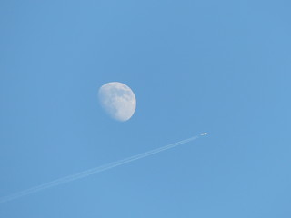 Plane flying past the moon 1