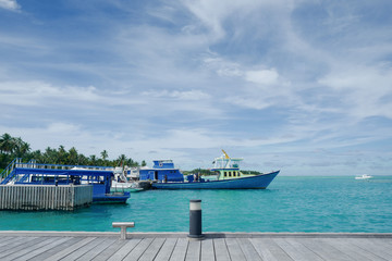 Summer concept , Sea port on beach white sand and turquoise sea color at maldives on the weekend holidays