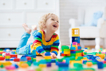 Wall Mural - Child playing with toy blocks. Toys for kids.