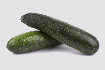 Two green zucchini close up. Still life. White isolated background.