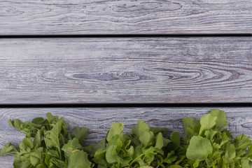 Leaves on wood and copyspace. Free space for text. Grey wooden desk background.
