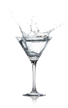 glass with splash of transparent alcohol drink
