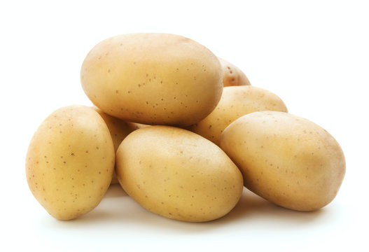 heap of raw potatoes isolated on white background
