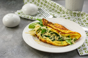 Omelette with spinach and cheese.