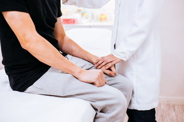 Physician doctor comforting a male patient in hospital room