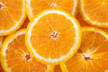 Colorful orange citrus fruit slices background top view