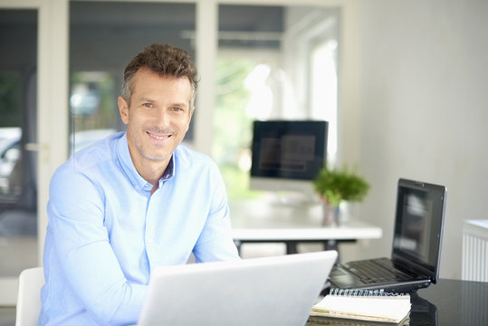 Successful businessman working on laptop at the office