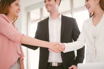 handshake business concept. business woman shaking hands in office.