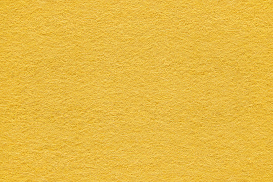 Yellow felt texture and background