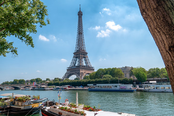 Eiffel Tower in Paris at the river Seine