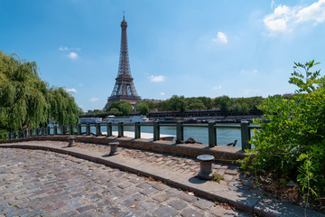 pier for house boats in front of the Eiffel Tower