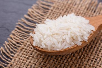 Jasmine rice on a dark stone background