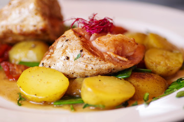 Pork with baked potatoes and vegetables