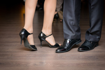 Male and female feet during slow dance. Elements of a dancing couple.