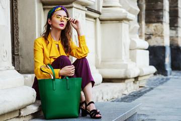Outtdoor full body fashion portrait of young beautiful woman wearing stylish headband, yellow...