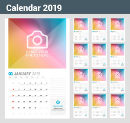 Wall calendar planner template for 2019 year. Vector design print template with place for photo. Week starts on Sunday