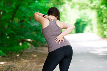 Woman with back pain, injury while running, trauma during workout