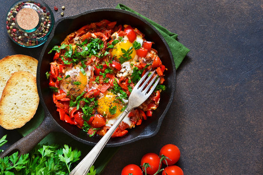 Shakshuka is a traditional breakfast of Israeli cuisine. Eggs fried in tomato sauce with pepper, onions and spices.