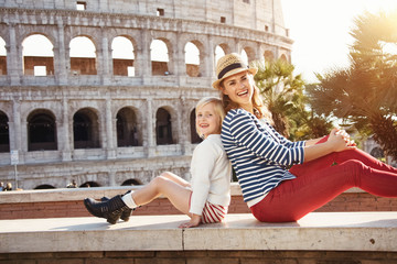 mother and daughter travellers near Colosseum in Rome, Italy