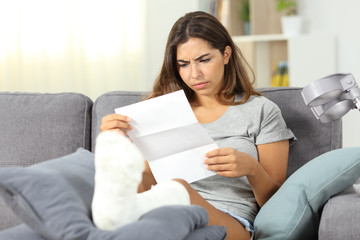 Worried disabled woman reading a letter