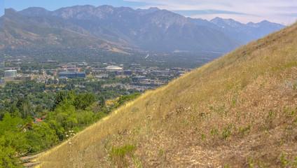 Mountan views of Salt Lake City from above a hill