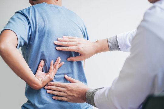 Doctor consulting with patient Back problems Physical therapy concept