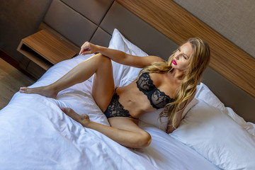 Beautiful Blonde Lingerie Model Relaxing At Home