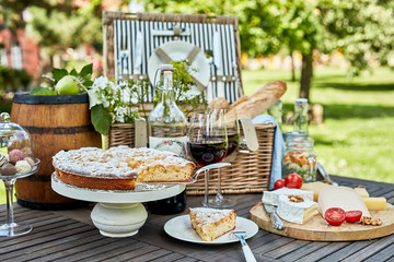 Assorted desserts and cheeses on wooden table